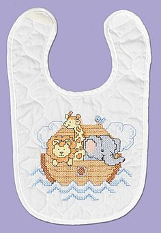 Noah's Ark Bib From our Neat and Nifty Line, the ark is full of all of our favorite animals, from elephants, to lions to giraffes.   New velcro closure!   Kit contains: One screen- printed 50% polyester/50% cotton prefinished quilted bib, 6- strand cotton floss, floss card, needle, graph, instructions.
