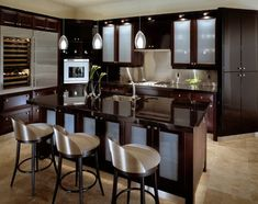 contemporary kitchen with glass cabinets