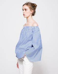 From Finders Keepers, an off-the-shoulder wide top with Blue and White vertical stripes. Features elastic shoulder line, full length sleeve, flare sleeve cut, flare hem, round hem and relaxed fit. • Off-the-shoulder top in Blue and White vertical stri