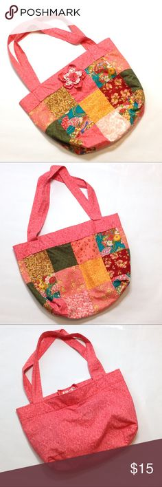 """🆕 Handmade colorful boho bag Found this in the corner of a consignment store and thought it was so cute! Especially if your strolling thru the farmers market and need a cute shopping bag! 🤗 Bag is 15"""" x 19"""" with a 12"""" drop. *Can personalize it by replacing the flower since just attached by safety pin. Or glue a large cute button onto the center of the flower. Handmade Bags Hobos"""