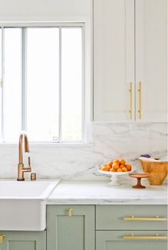 In this Los Angeles home, semi-custom cabinetry with rich brass hardware harmonizes with an IKEA sink and faucet to create a seamlessly stylish kitchen. The unique cabinetry color and classic brass accents allow the more affordable aspects of this design to easily blend in.