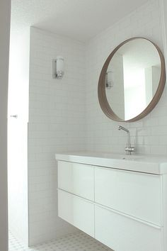 Bathroom with godmorgon vanity and stockholm mirror. In the fun lane.