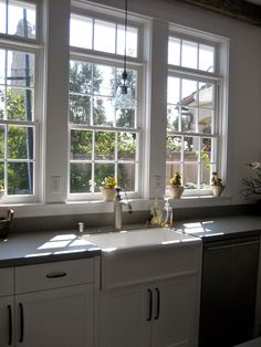 KITCHEN – More windows are needed in a kitchen. Transoms over the traditional windows bring in even more light. Boxwood Terrace