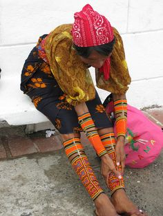 Panama |  Indigenous Kuna Indian with traditional beaded arm and leg wrappings