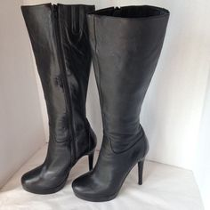 """ALDO black leather boots So sexy!  Stiletto black leather platform boots.  5"""" heel, 1"""" platform.  15"""" tall shaft,  14 1/2"""" leg circumference plus an extra 1"""" extender.  Side zipper .  Minor wear and scuffing, but in great condition.    Bundle and save.  Sorry no trades, please use Offer to negotiate. ALDO Shoes Heeled Boots"""