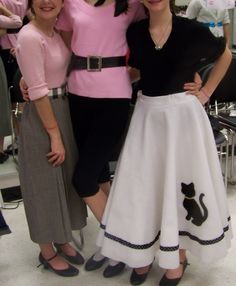 "Various characters--an ""academic"" with a pleated straight skirt, and ""edgy"" with capris and tight sweater and a ""poodle skirt girl"" with her skirt."