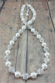 bling rhinestone necklace // pearl and rhinestone bridal jewelry by Amanda Badgley Designs http://www.amandabadgleydesigns.com/collections/necklaces/products/abby-necklace