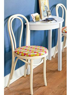 Bring bistro chairs back to life with a fresh coat of paint and bold seat fabric.