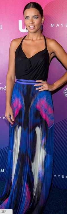 Adriana Lima in Haute Hippie Emebellished High Low Blouse and Gabriela Cadena floral purple print maxi skirt