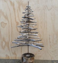 Driftwood Christmas Tree | Frk Hansen I've seen driftwood trees like this for sale at the stores for over $200! Why pay that when you can get the wood for free? This tree is perfect for spaces that can't take a huge pine or for those of you who want...