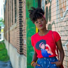 Love the afro take on Rosie the Riveter || Cyn in the Naturally Revolutionary tee natural hair global couture