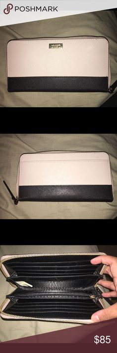 Kate Spade Laurel Way Zip Around Wallet Kate Spade Laurel Way zip around wallet in gray/ black color block. This wallet is slightly used but in great condition! No markings on the leather outside or inside cloth. There are just small scratches on the gold Kate Spade emblem in front. Open for negotiation. No trades. kate spade Bags Wallets