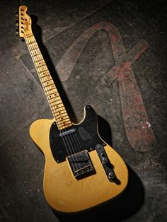 Fender Telecaster.  Love the wear and tear on the body of this guitar.  Really gives it character.