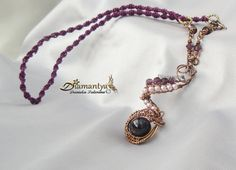 wire wrapping pendant, oxicide copper, swarovski elements,macramè and amethyst bead.
