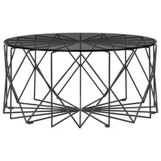 Bolia+Vitro+Coffee+Table+Glass+Top+Grey+L+-+Black+steel+geometric+coffee+table+with+round+glass+top. Invite+the+striking+graphic+appeal+of+the+Bolia+Vitro+Coffee+Table+Grey+Glass+Black+Frame+90cm+into+your+home. Creating+affordable+luxury+furnishings+for+the+home,+this+collaboration+between+Granstudio+and+Bolia+creates+a+geometric+focal+point+for+contemporary+lounge+and+lobby+settings. Welded+together+using+rods+of+powder+coated+steel,+the+structural+base+creates+a+spirographic+effect. Cr...