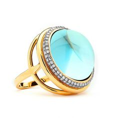 Large blue topaz ‎#ring with champagne ‎#diamonds by Syna.
