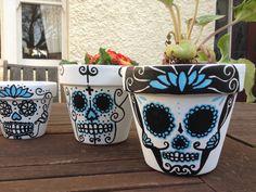Fun! Dia de los Muertos Skull Pots. $30.00, via Etsy.