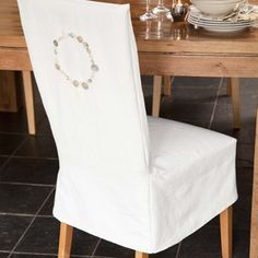 Close-up of closure detail on dining chair slipcover | She\'s ...