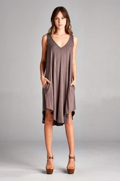 Loose fit, sleeveless, scoop V-neck, swing dress. Has very rounded hems. Has side pockets. Scoop V-back. This dress is made with heavyweight knit jersey that is very soft, drapes beautifully and stret