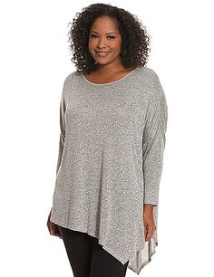 Soft knit tunic is a trend-perfect partner to your favorite Fall jeans and leggings with its asymmetric hem and fashionable space dye motif. Flattering scoop neck and 3/4 sleeves complete the look.  lanebryant.com