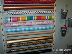 Organize wrapping paper using cafe curtain rods