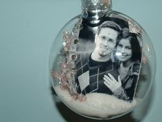 Christmas Photo Bulbs (assuming you can find the right sort of clear flat decorations!)