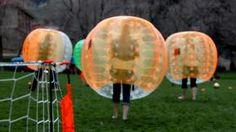What is Bubble Soccer. Bubble Soccer (or football if you're from Europe) has spread to Canada. As seen in the Photos/clip it is all about smashing into each other, bouncing around and rolling across the grass in inflatable Zorb like balls.. Forget faking an injury while you're ensconced in the balls, is anyone keeping score? You'll be laughing too ... Bubble Soccer, Soccer Games, Things That Bounce, Laughing, Balls, Toronto, Grass, Bubbles, Forget