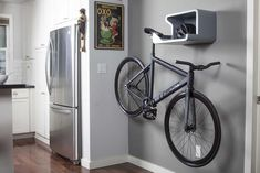 All of your bike gear in one location. A bicycle storage solution that holds your bicycle by the seat and has room for helmets, shoes and water bottles.