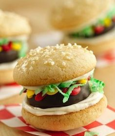 """You've already got burgers on the menu so why not whip up these sweet sliders to go along with them? Fill the sugar-cookie """"buns"""" with peppermint patties, frosting and all sorts of goodies for a fun addition to the treat table. One of Betty's most-shared recipes on Facebook!"""