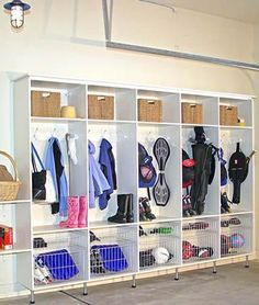 Coat locker system in the garage for the kids' sporting equipment, coats and shoes. No clutter in the home! Design by White Rabbit Garage Organizers, Chicago