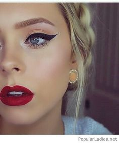 Orange eye makeup, red lips and awesome earrings