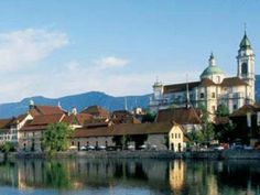 Solothurn, Switzerland  ...beside the Aare River.  Solothurn has 11 Churches and chapels; 11 historic fountains; 11 towers; cathedral, 11 bell and alters.