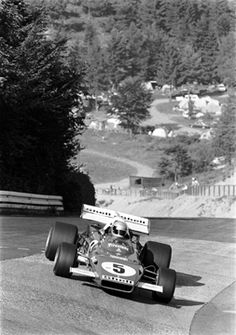 "Mario Andretti enters the ""ditch"" of the Karussel with the Ferrari 312B/2 at Nurburgring in 1971. He would finish fourth."