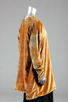 A Mariano Fortuny stencilled velvet jacket, circa 1920-30, circular Fortuny label to the lining, of soft amber silk velvet stencilled with ivy leaves to the shoulders, upper sleeves and cuffs in silver, re-lined in brown satin,