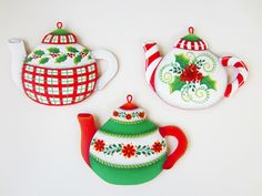 """A TaTa Robin Design, Decorative Painting Pattern Packet #310 """"Christmas Teapots"""".  Availble in E -Packet.  Winter / Christmas Flowers & Holly. Personalize on the back with a merry saying to give to one of your tea loving girlfriends!  Wooden Teapot Ornaments available on my website:  http://www.tata-robin.com/"""