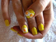 Yellow nail polish and fried egg nail art! Add some bacon & it's one of the coolest things I've ever seen!