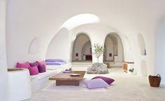 Greece Cyclades Oia interiors architecture Perivola Suites living room white minimalist purples