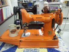 wow, maybe i'd sew a bit more if i had an orange sewing machine