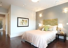 Bedroom with partial wall separating bathroom-closet