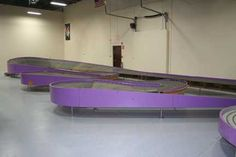 "The legendary Sovereign slot car track was built in 1965 for Playland Raceway in San Francisco.  After being in storage for 45 years, it has been restored and is now in operation at Modelville Hobby Shop in Ashland, MA.  The Sovereign, nicknamed ""The Purple Mile"", is the largest slot car track ever built."