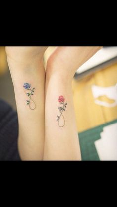 One symbol with my girls' birth flowers on it