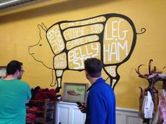 Visitors who walk in to The Local Pig, 2618 Guinotte Ave., in Kansas City are greeted by this mural, which explains exactly what they are about to buy. (Peggy Lowe/Harvest Public Media)