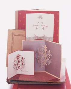 With a few basic techniques, you can create a wide range of looks by varying shapes, color, and decorative details. These snowman and snowflake pop-ups are decorated with glitter and glue, and inscribed with a fountain pen dipped in red ink.