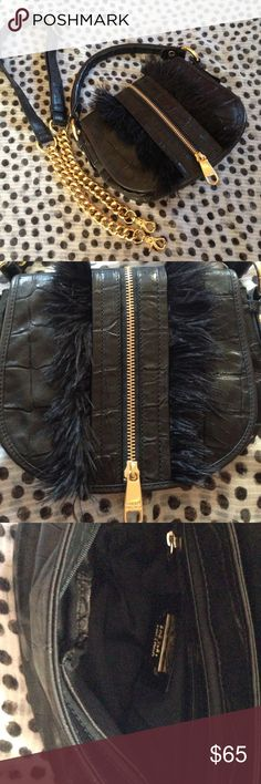 Badgley Mischka Feather Handbag Beautiful Badgley Mischka black leather handbag with detachable shoulder strap. Feather details down the front and decorative gold zipper and hardware. This bag has been worn maybe 3-4X and is is excellent condition. Inside has one zip pocket and two open pockets. Badgley Mischka Bags