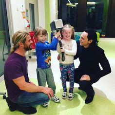 Chris Hemsworth and Tom Hiddleston with young fans