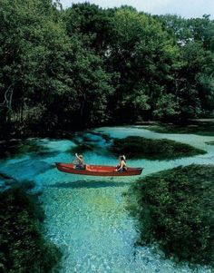Slovenia: the water is so clear it looks like their boat is floating in the air.