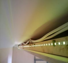 The LED strips are clipped to the supporting framework a few centimetres back from the edge of the dropped ceiing.
