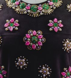 Yves Saint Laurent Haute Couture, automne-hiver 1968-1969 ROBE DE COCKTAIL EN DAIM BRODÉ DE PIERRERIES PAR LA MAISON LESAGE, BLOUSE EN SATIN ROSE TYRIEN, UNE AUTRE EN SATIN NOIR YVES SAINT LAURENT HAUTE COUTURE, A/W 1968 A BLACK SUEDE FRINGED TUNIC WITH JEWELLED MEDALLIONS BY MAISON LESAGE WITH TWO OPTIONAL PINK AND BLACK SILK BLOUSES