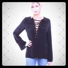 """Winona Bell Sleeve Top Winona Bell Sleeve Top - Brand new, never worn except for trying on. Excellent condition! Black bell sleeve top with black crisscross lacing down the front. Has a high low hem. Recently purchased from another seller here on PoshMark, but the sleeves are too long for me. I'm 5' 1"""", my arms are too short for the sleeves. Cotton Candy LA Tops Blouses"""