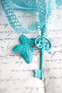 Turquoise key on a lace lanyard.